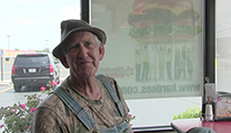 Thumbnail of Ray Ball sitting at a table in Hardee's.