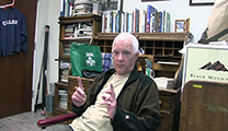 Thumbnail of Andrew Herd sitting in an office with a old fashion rolltop desk in the background.