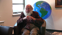 Thumbnail of Reed Howald sitting in the Montana State University Merrill G. Burlingame Special Collections Reading Room.