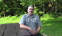 Thumbnail of Matt Kulp sitting at a picnic table in Great Smoky Mountains National Park.
