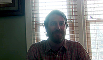 Thumbnail of Ladd Tucker sitting in front of a bright window.