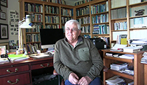 Thumbnail of Jim Lichatowich in his office surrounded by books other items needed for research and writing.