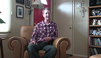 Thumbnail of Beau McFadyean sitting in leather arm chair in his living room.