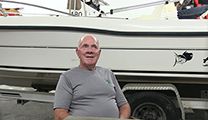 Thumbnail of Steve Moore sitting front of a boat.