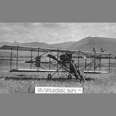 Dual Winged Aircraft in Grassy Field with Pilot at the Controls, Twin Bridges, Montana, ca. 1900s