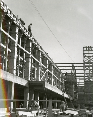 Men working on the construction of Romney Gym