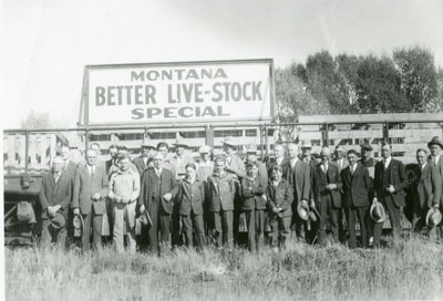 Group of men posing in front of Montana Better Livestock Special Train