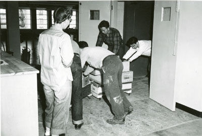 People unloading boxes out of the elevator for the Library move 1949/1950