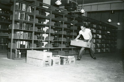 Man moving boxes for the library move 1949/1950