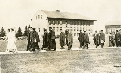 Graduates walking down the mall at Commencement, 1933
